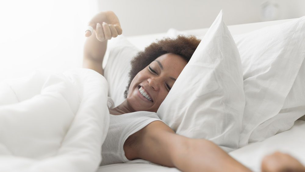 woman waking up, looking well rested