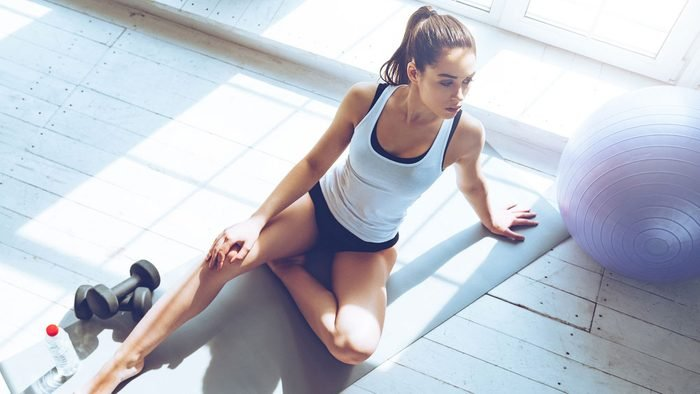 woman thinking to herself after a fitness class