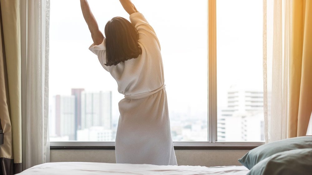 woman stretching after a good night's rest
