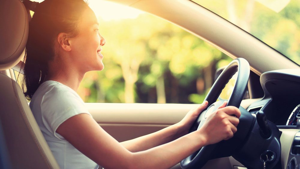 can't stand the noise_ woman driving alone smiling