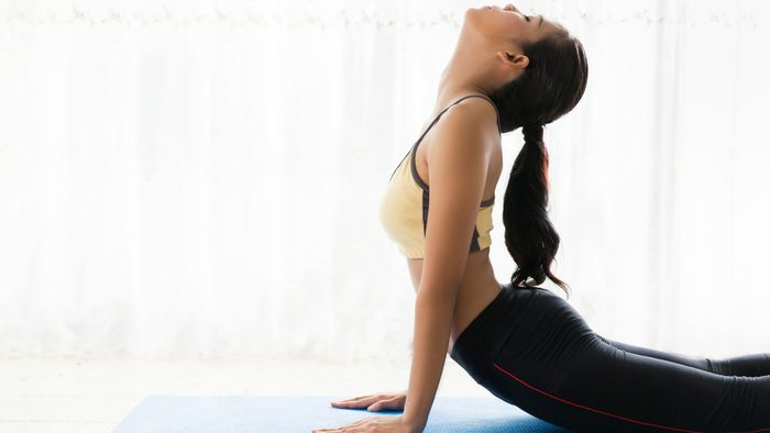 can't stand the noise_ Woman doing cobra yoga pose