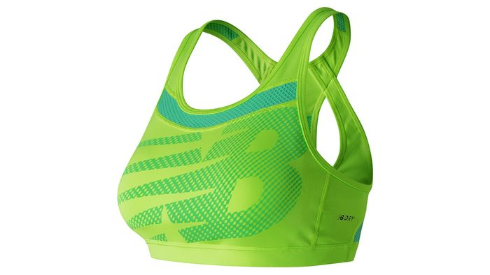 green sports bra with racer back support and NB-logoed front