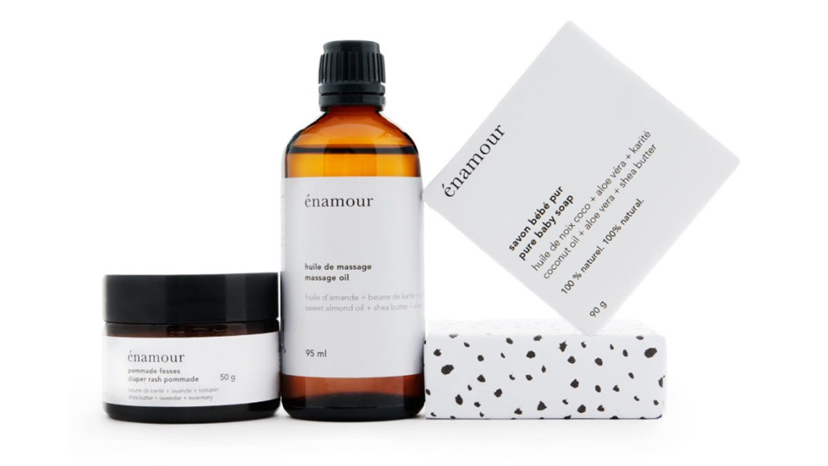 Pretty white and black packaging of soap, oil and cream