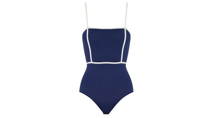 navy one piece suit with a contrasting white piped waistine and straps