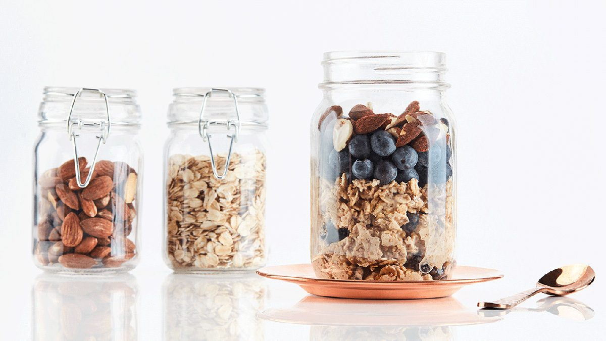 Jars of oats and blueberries