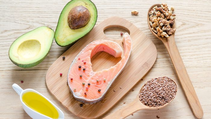 display of salmon, nuts, avocado and oil