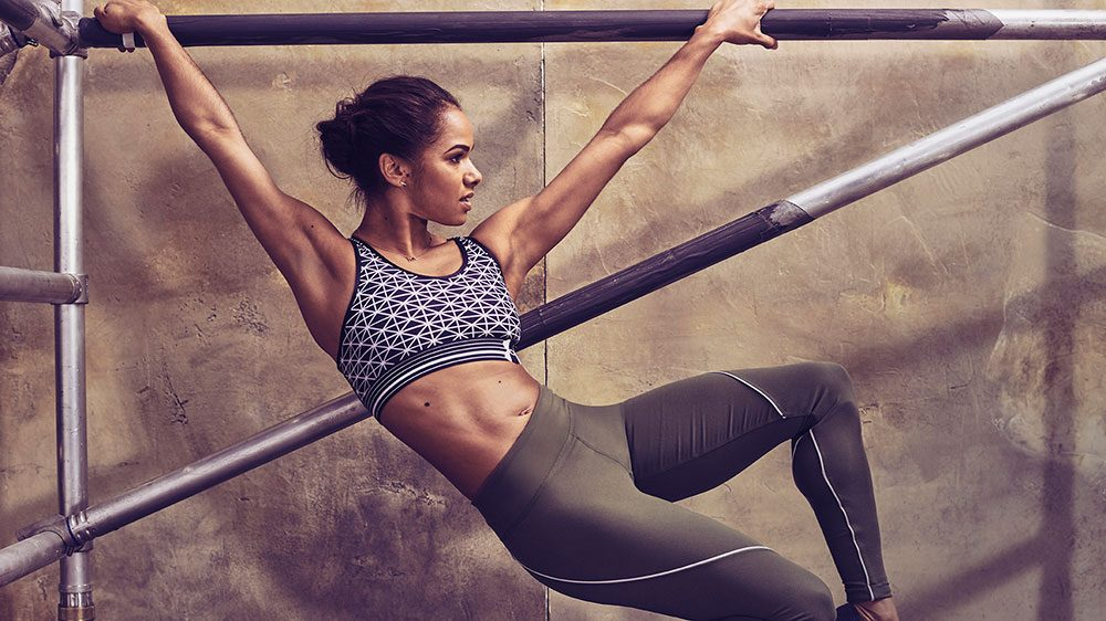 Misty Copeland stretching her upper body