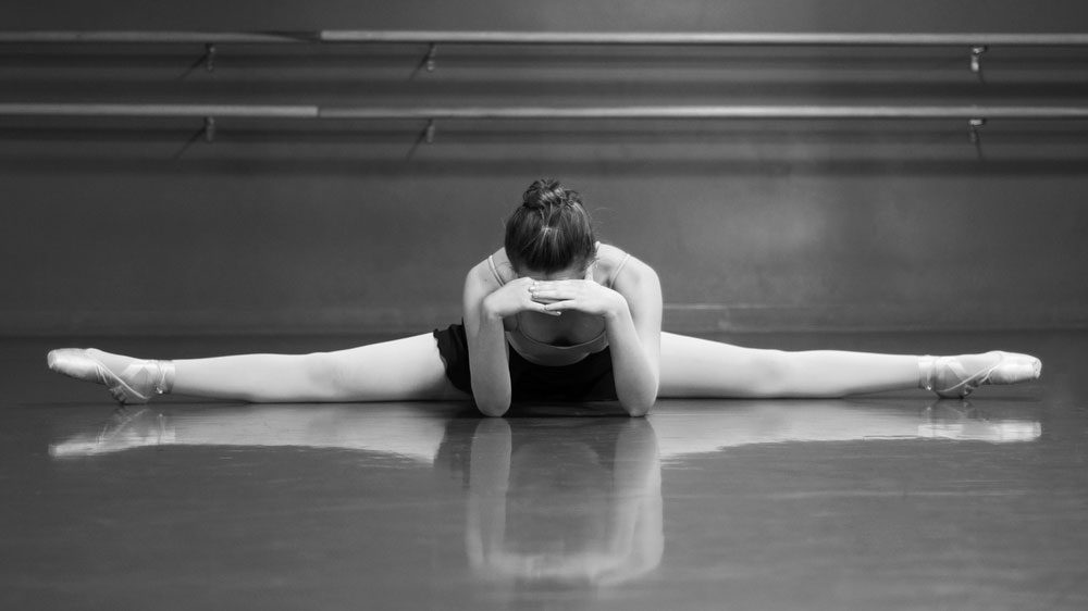 Ballerina meditating on the floor