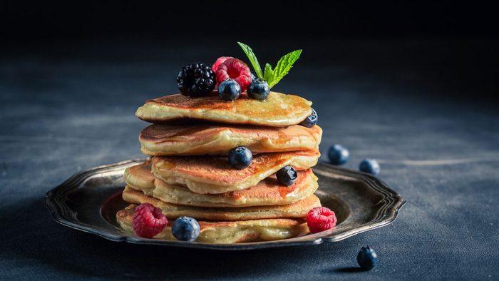 vegan breakfast, vegan berries topped with strawberries and blueberries