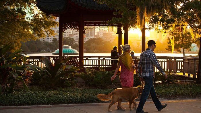 Best Health Travel Orlando couple walking on a boardwalk