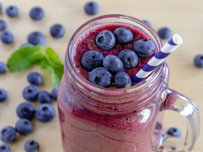 A healthy breakfast fruit smoothie recipe with blueberries, orange and yogurt.