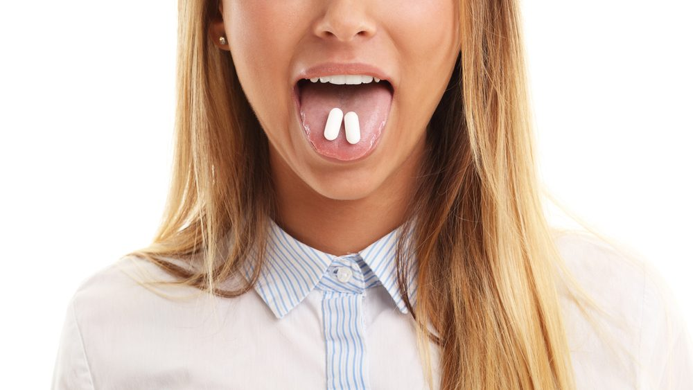 Best Health Pain Awards 2017, a woman taking a pill