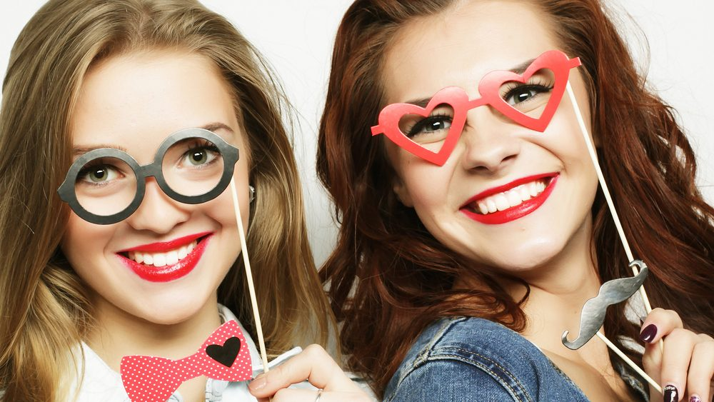 Best oral health, with two girls with pretty smiles