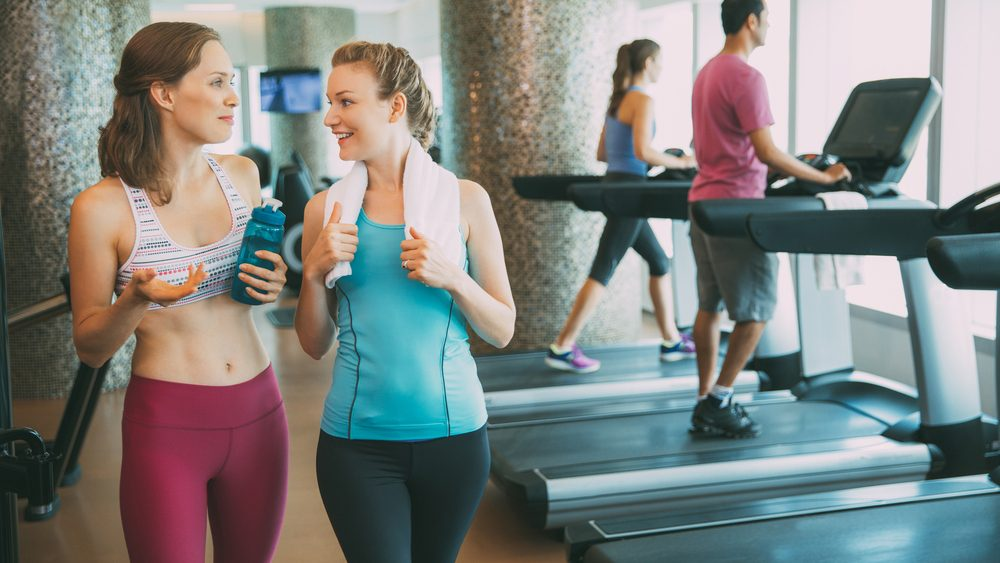 Exercise Prescription for heartdisease: women at the gym going from walking on the treadmill to lifting weights