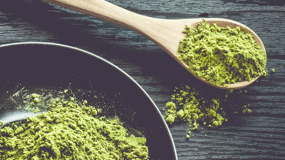 Health Benefits of Matcha: bowl and spoonful of matcha