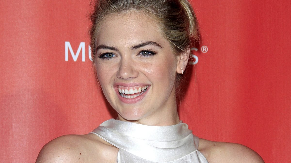 Smiling Kate Upton doesn't care about her weight
