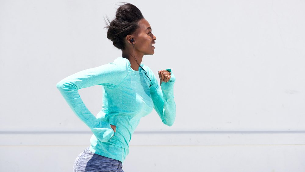 Ruining hearing, woman runs with earbuds