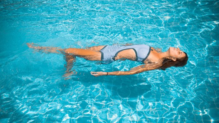 Ruining hearing, woman swimming with water past her hairline