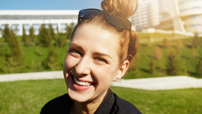 Ruining hearing, woman smiling in a park