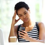 How to spot fake health news, woman reading her cell phone