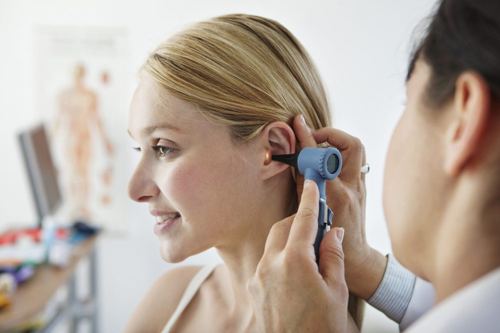 woman at the doctors__ ringing ears