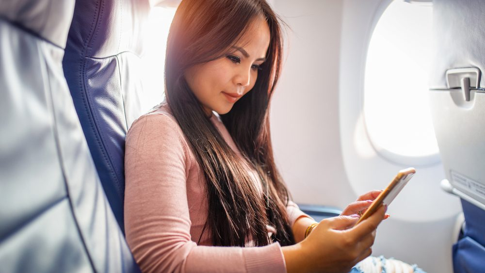 Ruining hearing, woman on a plane about to embark