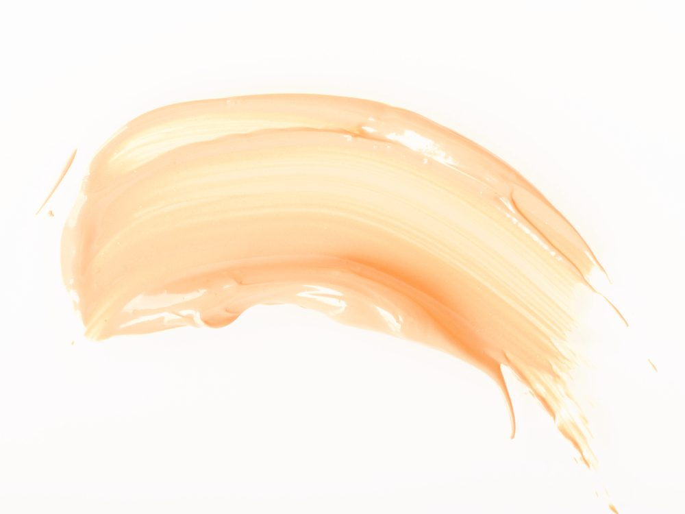 Smoothing on tinted moisturizer can help you look less tired