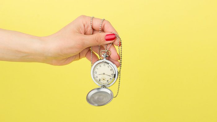 diagnosed with melanom, a woman holding a pocket clock