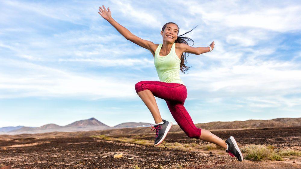 eat before a run when you're hyper, a woman jumping during her run