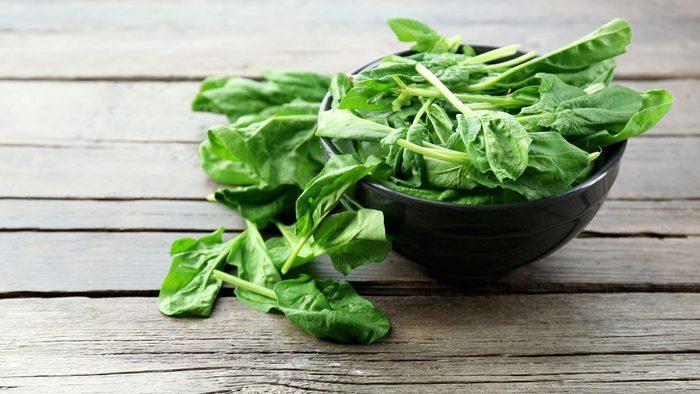 garden planning salad greens, bowl of spinach