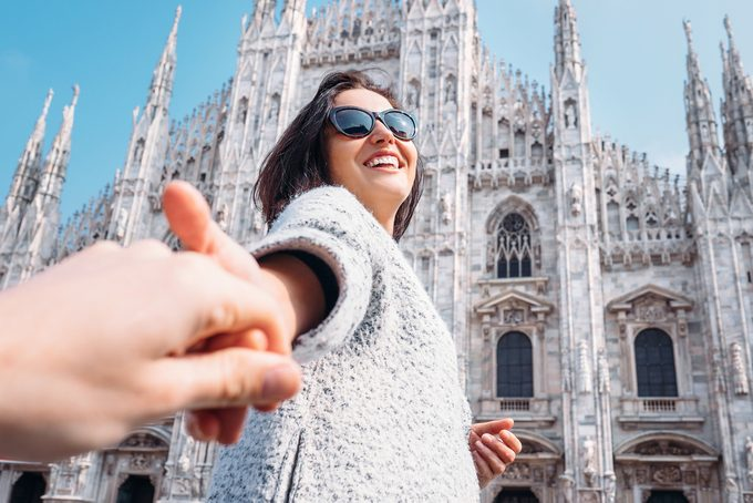 happy woman on vacation_ save for a dream vacation