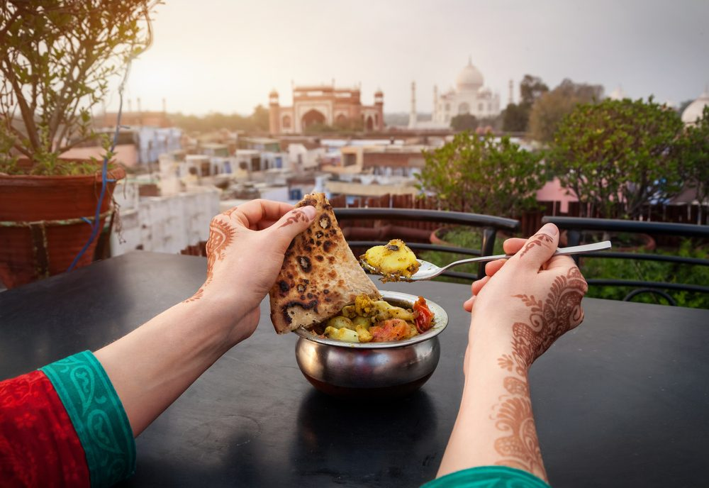woman eating food in india_raised by a racist