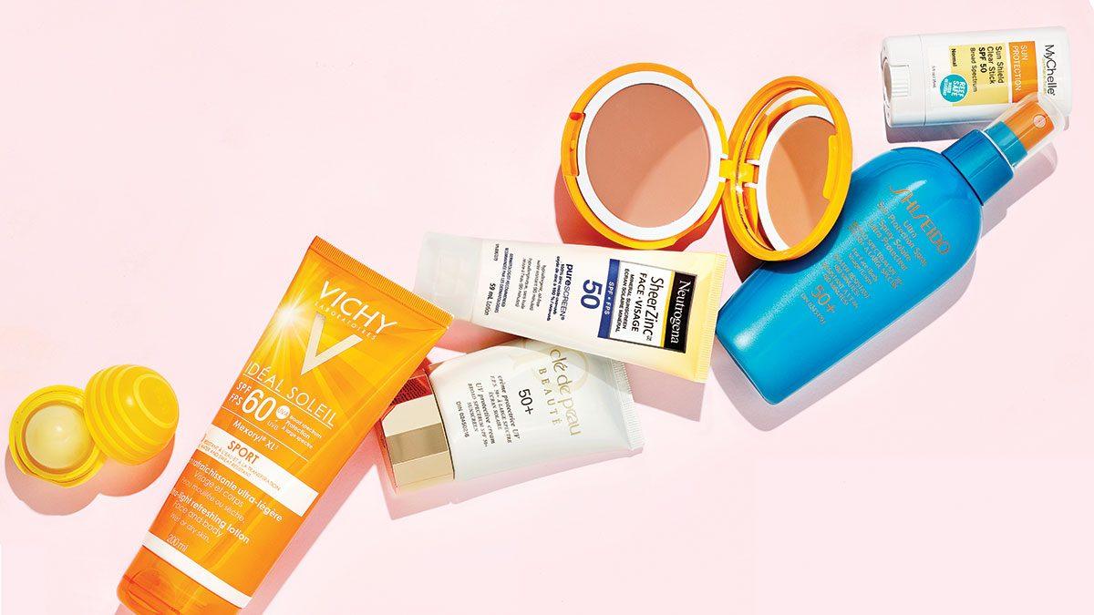 right way to wear sunscreen, a flat lay of sunscreen bottles