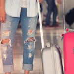 travel with cancer, a woman with her suitcases