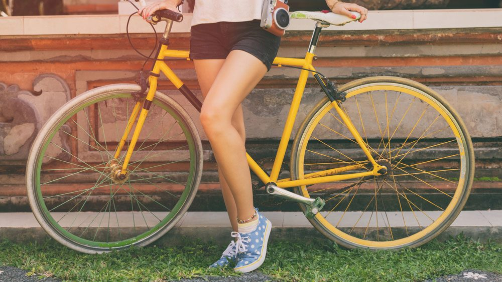 cellulite fixes, a woman in shorts hiding her legs