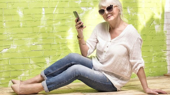 how to live longer, a beautiful older woman in jeans and heels living the life!