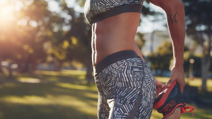 staying motivated in summer, a woman with abs