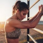 staying motivated in summer energy, woman in workout gear looking exhausted