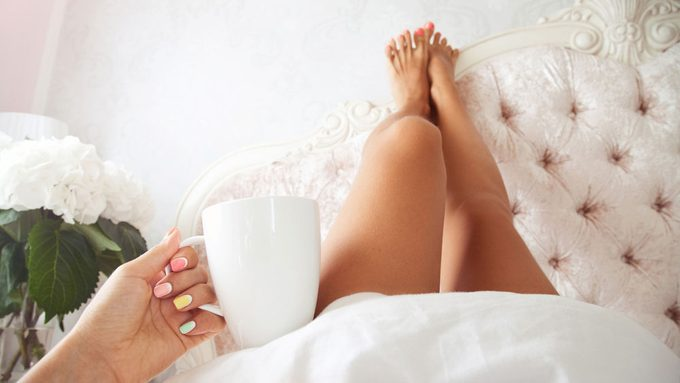 use men's razor on legs, a woman in bed with freshly shaven legs