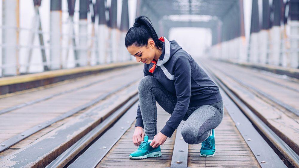 family life balance running, woman running on a bridge