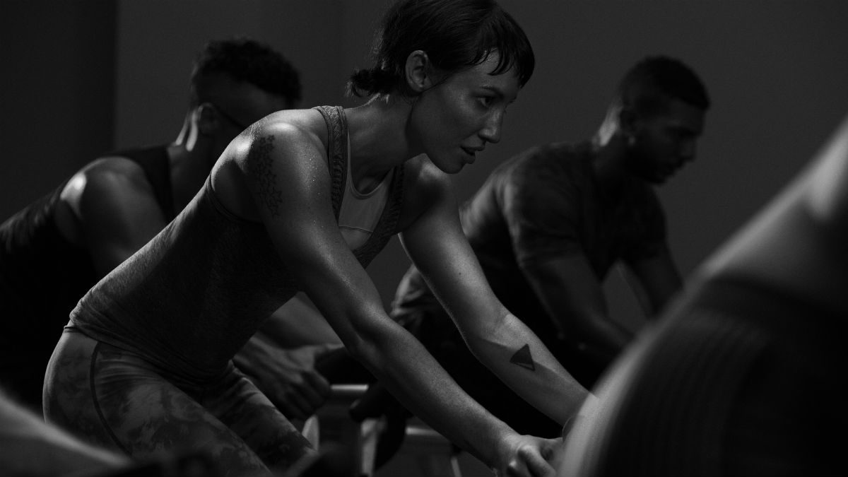 vancouver fitness classes Equinox pursuit, woman on a spin bike