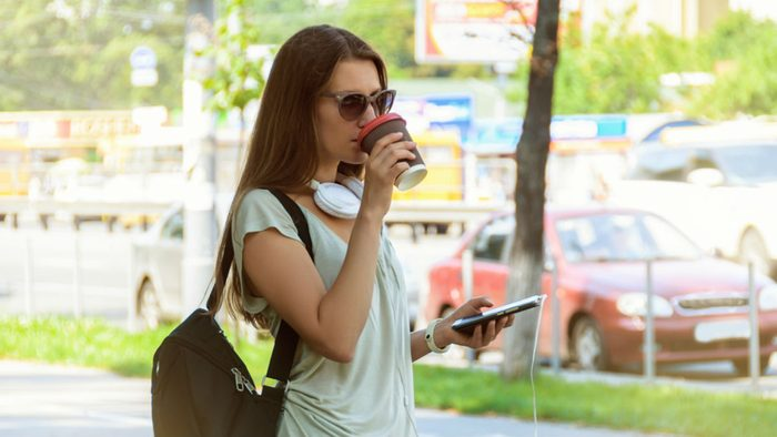 wellness getaways habits, a woman drinking greentea