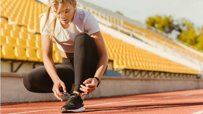 wellness getaways mini workouts, a woman getting ready for a quick run