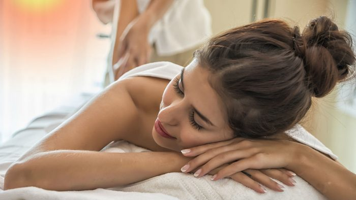 wellness getaways put yourself first, woman getting a massage
