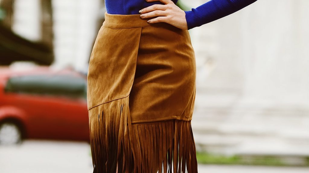 Fall wardrobe, woman wearing fringe skirt