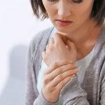 Relieve carpal tunnel, woman holding her wrist