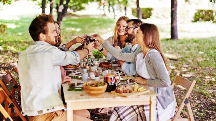 Thanksgiving food prep, family gathered around table
