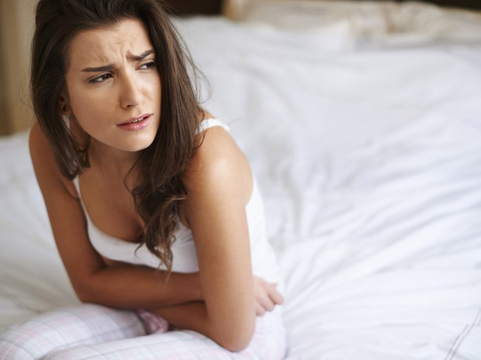 prevent urinary tract infections. woman suffering from a UTI