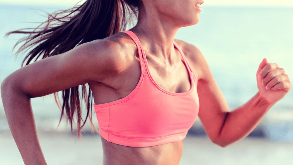 fat burner vs sugar burner, woman running in sports bra
