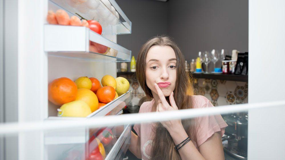 healthy turkey leftovers, woman looking in fridge